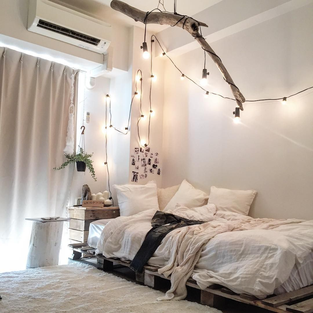 the pallet bed the lights the branch the colors everything