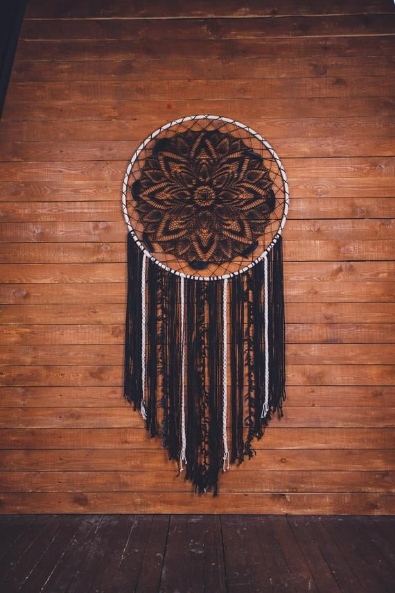 Would this black bohemian dream catcher wall hanging melt your heart? Absolutely. This is a beautiful handcrafted boho wall art piece that will bring peace and serenity to your bedroom. Consider this large dream catcher, if are looking for a gift for a boho lover. Amazing wall art for a dream bohemian home. Pure beauty. #dreamcatcher #dream catcher #bohodecor #bohohome #black