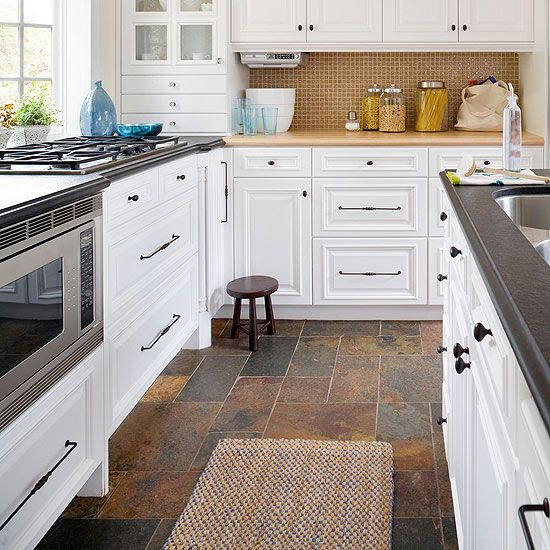 Large slate tiles provide a sound, stylish surface underfoot, and the color hides dirt, pet hair, and more. To maintain the flooring, the homeowners reseal it with a matte-finish product once a year.