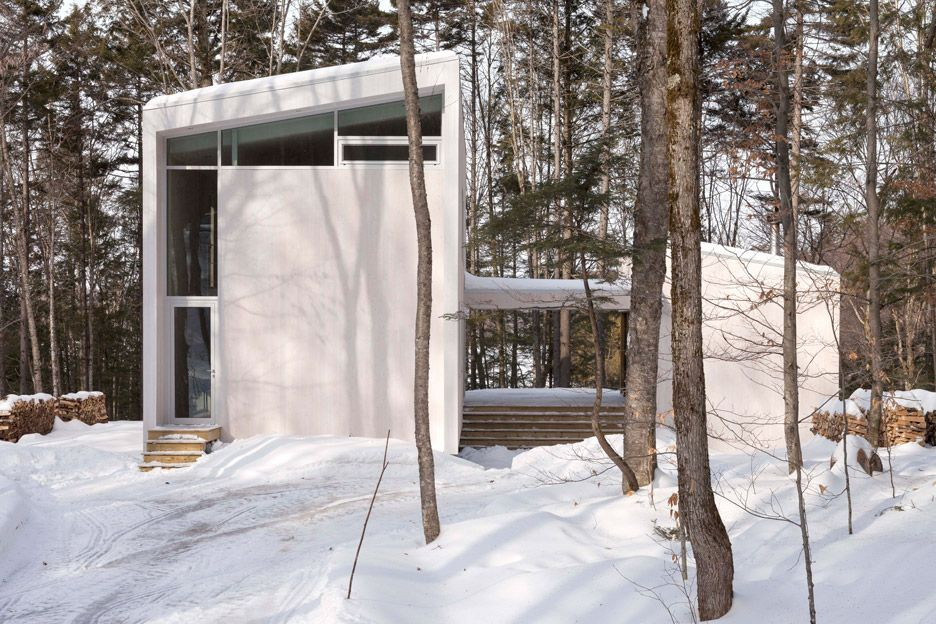 Atelier Pierre Thibault has completed a holiday home in rural Quebec with a giant window wall that provides expansive views of the scenic terrain