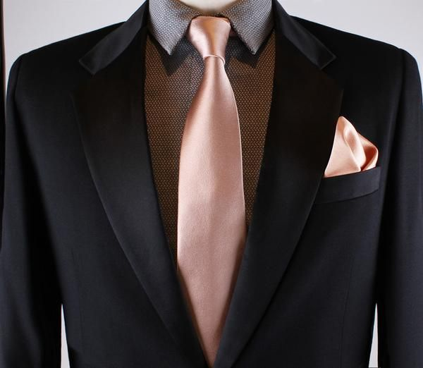 c238ce3dbb035 Description Silk rose gold pocket square. This item is extra special  because of its hand rolled hem, giving it a true artisan, luxury finish.