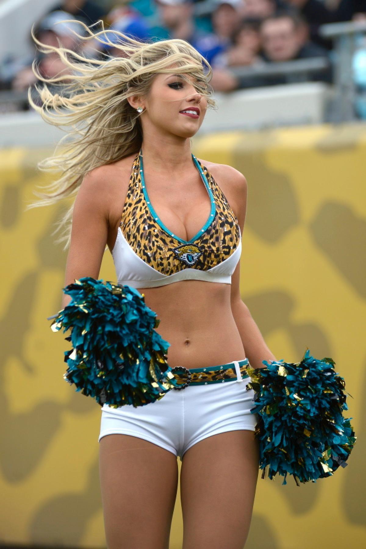 nfl cheerleaders show off their team spirit in week 15 nfl