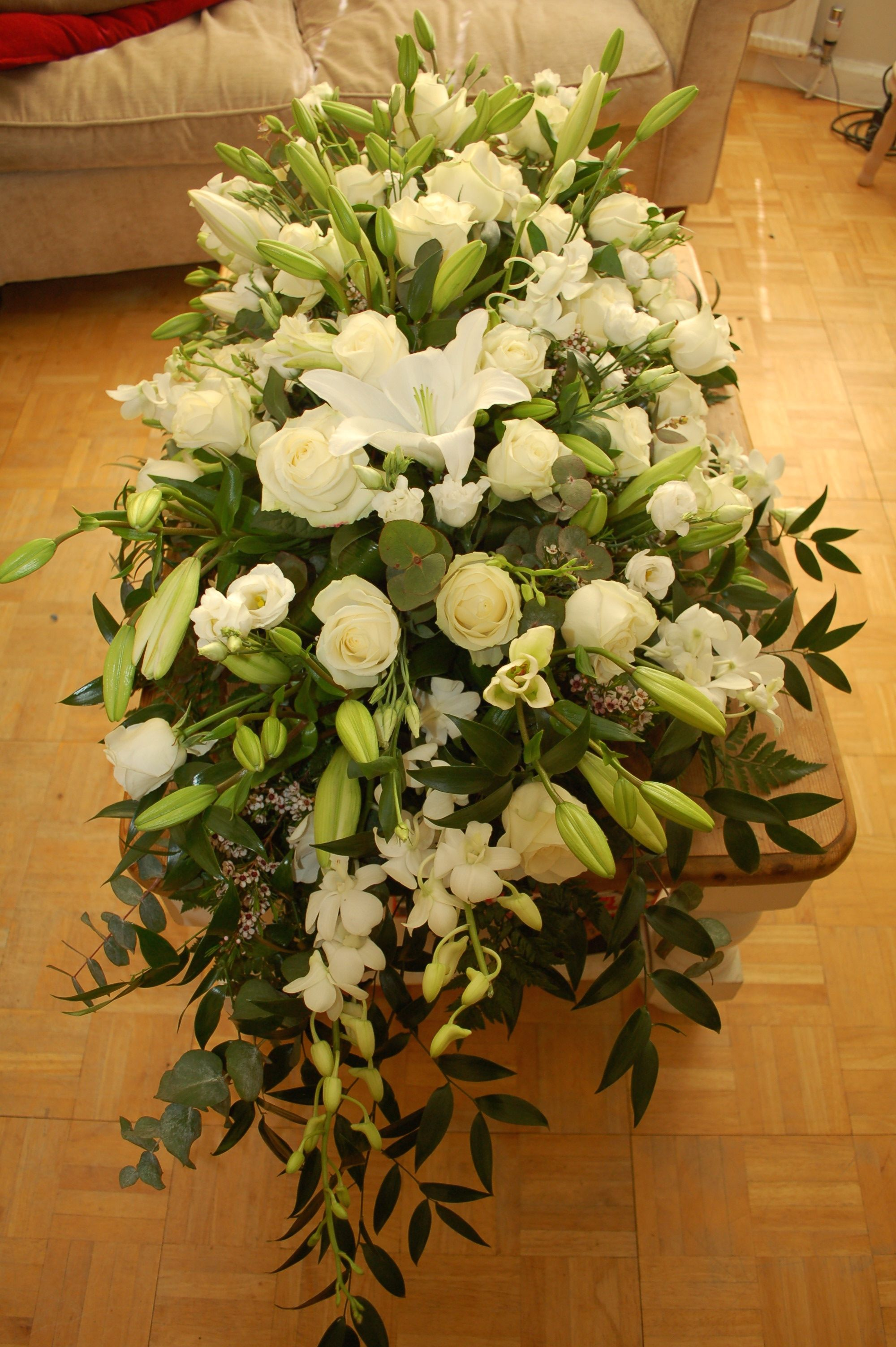 Casket spray lilies roses and orchids bishopandpolden floral casket spray lilies roses and orchids bishopandpolden izmirmasajfo