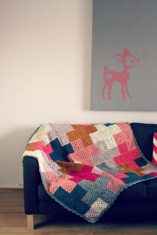 From Muita Hania. Solid colored granny squares artfully arranged to create a visually stunning throw.