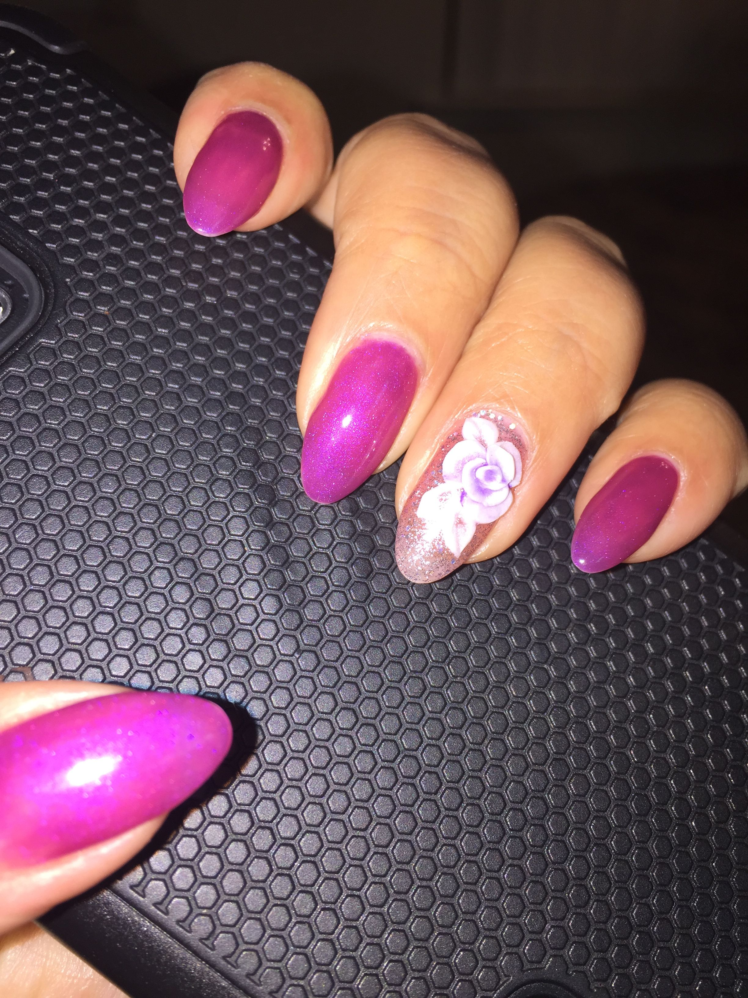 Purple almond shaped nails with a 3D flower. Love them!