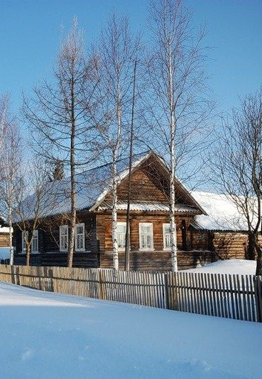 Russian wooden house and a wooden fence in a winter village. #Russian #wooden #house #winter
