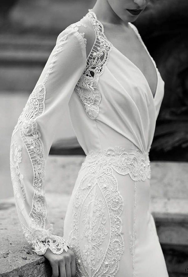 The delicate fabric of this fall wedding dress seems to envelope the ...