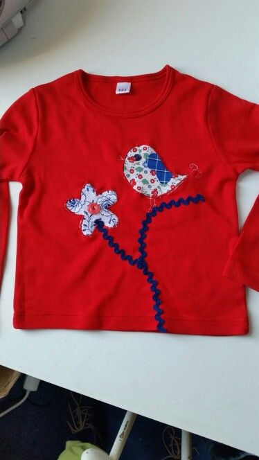 Hartelief ecocotton baby shirt with application of folkloric fabrics from Staphorst
