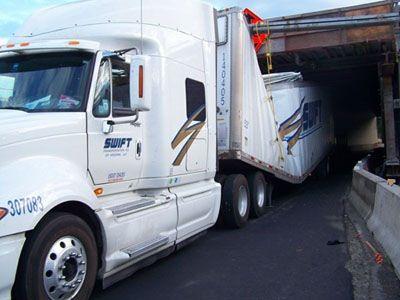 Swift Semi Stuck Under Interstate 84 In Oregon After Low Bridge