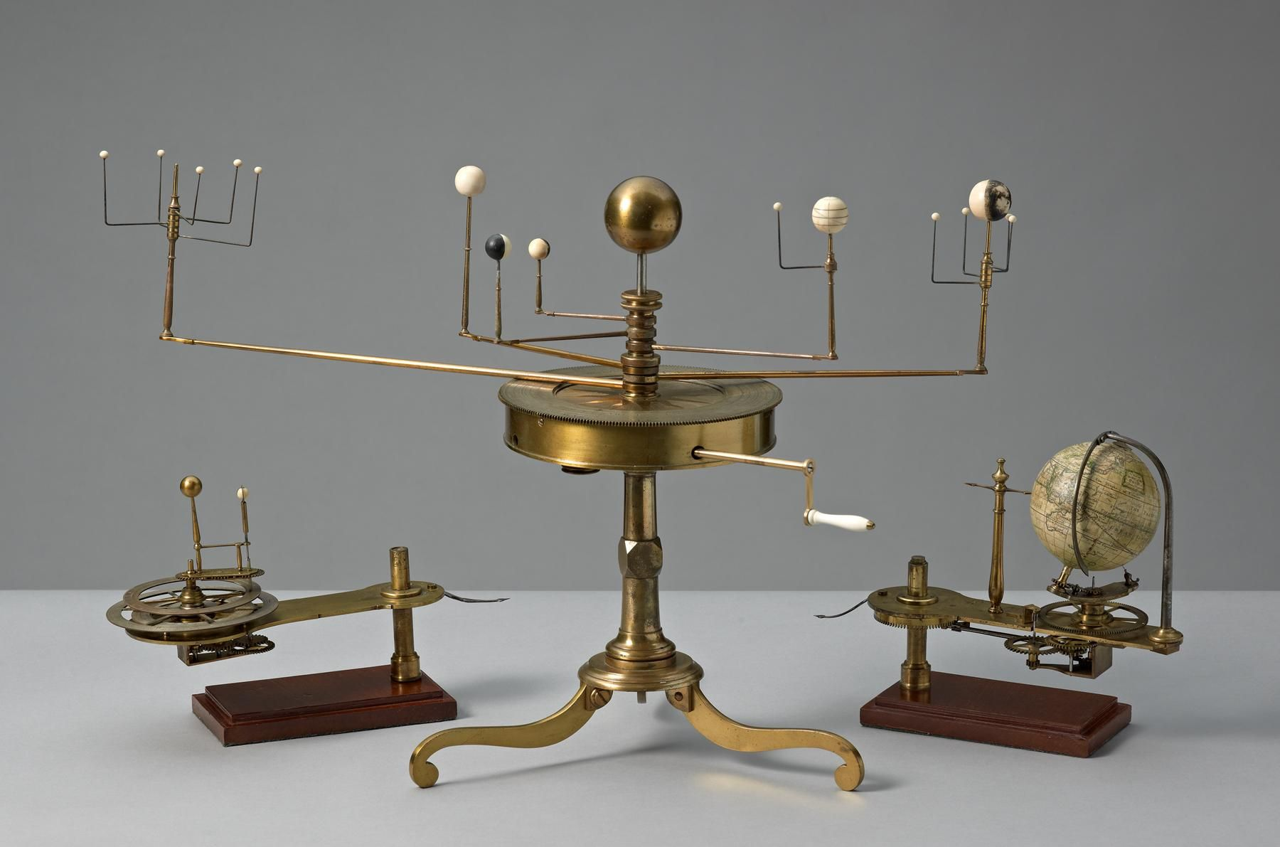 "A rare Benjamin Martin brass orrery. The silvered ring is engraved with a calendar scale and signs of the zodiac, signed ""B. Martin Invt et Fecit Londini"". Planets are Mercury, Venus, Mars, Saturn, Jupiter, Earth & their moons."