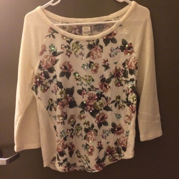 American Rag white rose print sweater Lightweight pullover waffle weave sweater with adorable rose print and itty bitty sequin details on back and front! Worn once, purchased during 2015 Black Friday sales. Minuscule hole in back (see detail photo). Pair with jeans and tank top or pullover a cute summer dress to add some girly chic to your outfit! American Rag Sweaters Crew & Scoop Necks