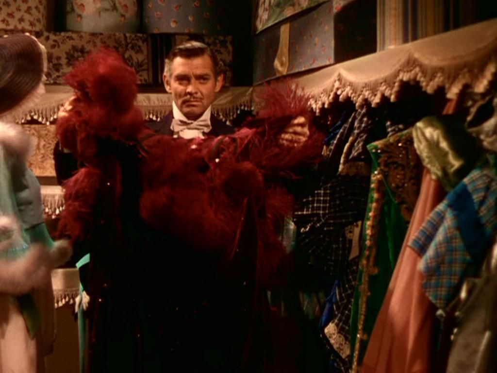 RHETT Get dressed. Wear that! Nothing modest or matronly will do for this occasion. Put on plenty of rouge! I want you to look your part tonight!