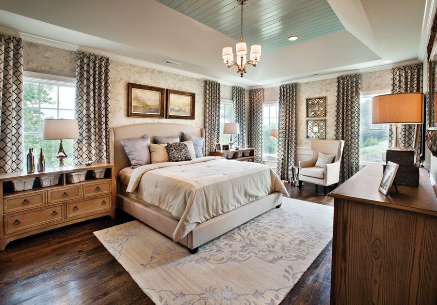 Master Bedroom With Wood Floors Large Carpet Rug And Wallpaper