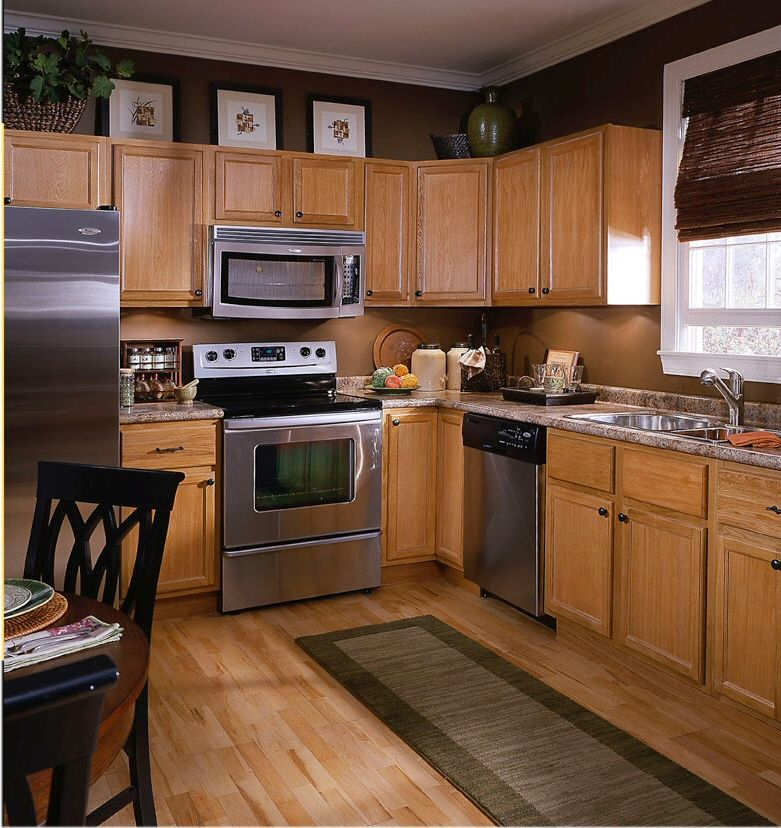 Pin By Terrah Nickel On Kitchen Brown Kitchen Cabinets Brown Kitchens Light Oak Cabinets
