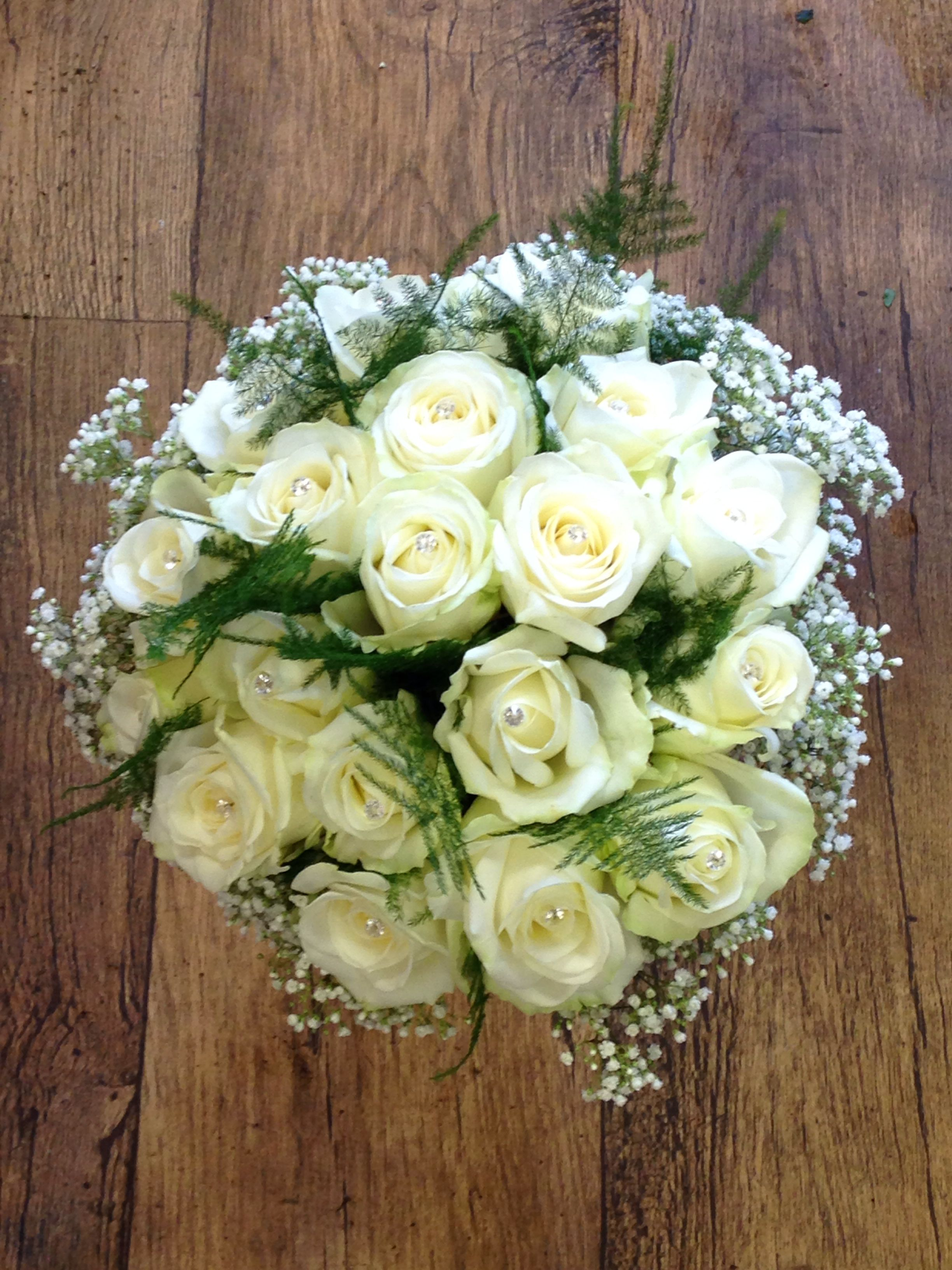 Avalanche Roses with gem centres , fern and gyp edge .
