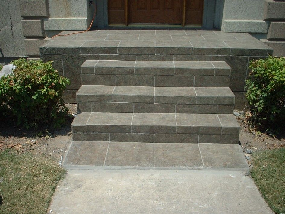 Exterior posh gray step ladder concrete porch with blue for Outdoor steps ideas