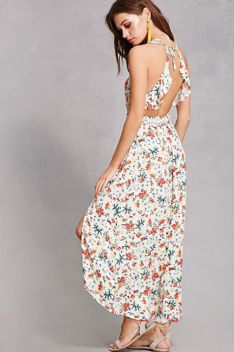 50fd6eac3804 A floral woven maxi dress by Lush™ featuring a floral print, ruffled sleeves,  open-back, self-tie closure, smoked waist and side slit.