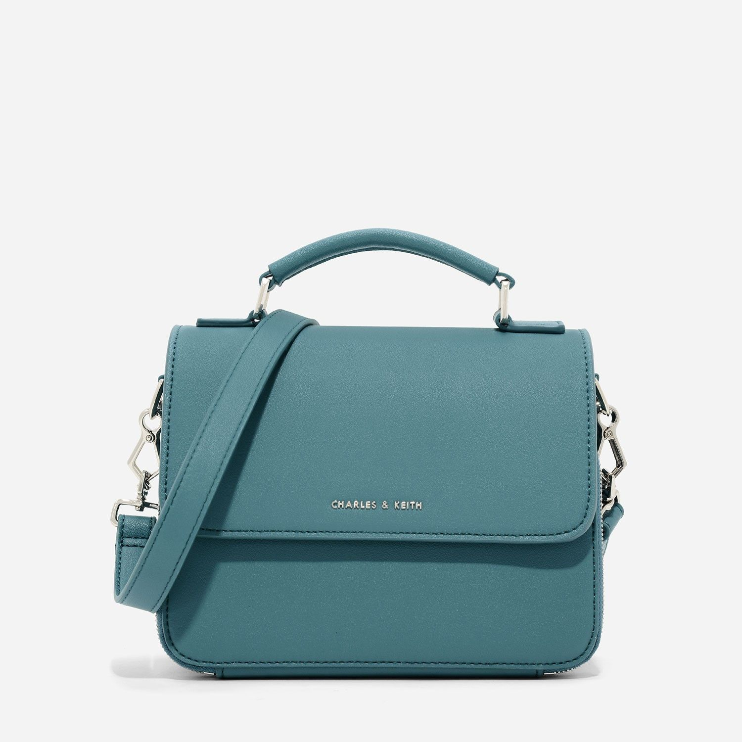 Charles Keith Bags Teal Top Handle Sling Bag Featuring Front Flap And Magnetic Closure