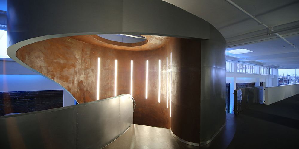 ajando staircase tower, Hafenpark Mannheim - entrance from the gallery - design by Peter Stasek architect, wall light Log In by Molto Luce