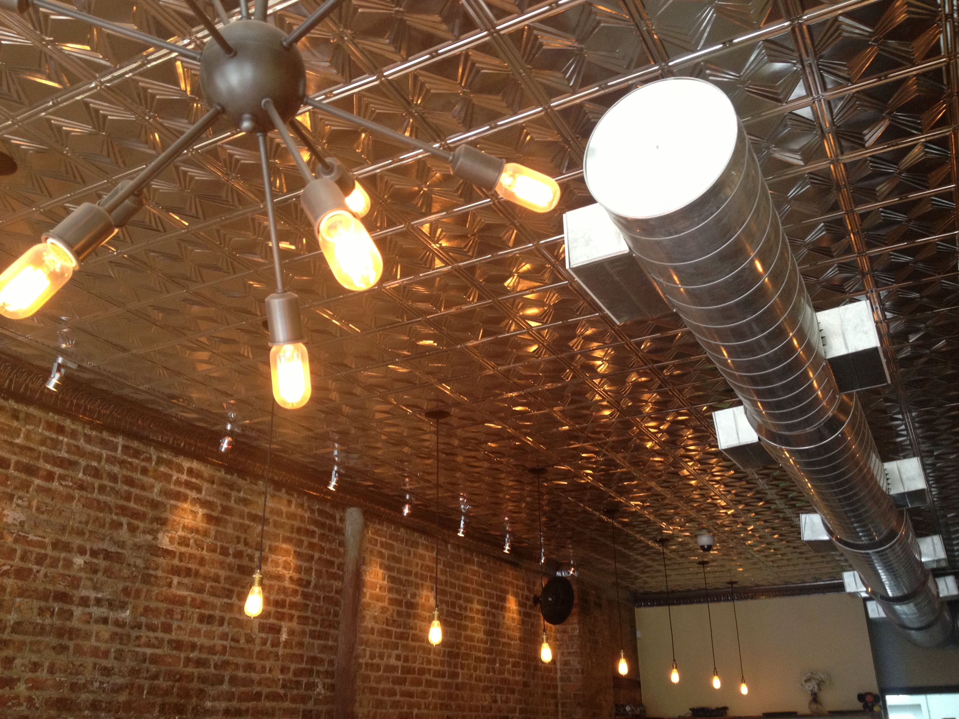 Tin ceiling with brick wall exposed duct work