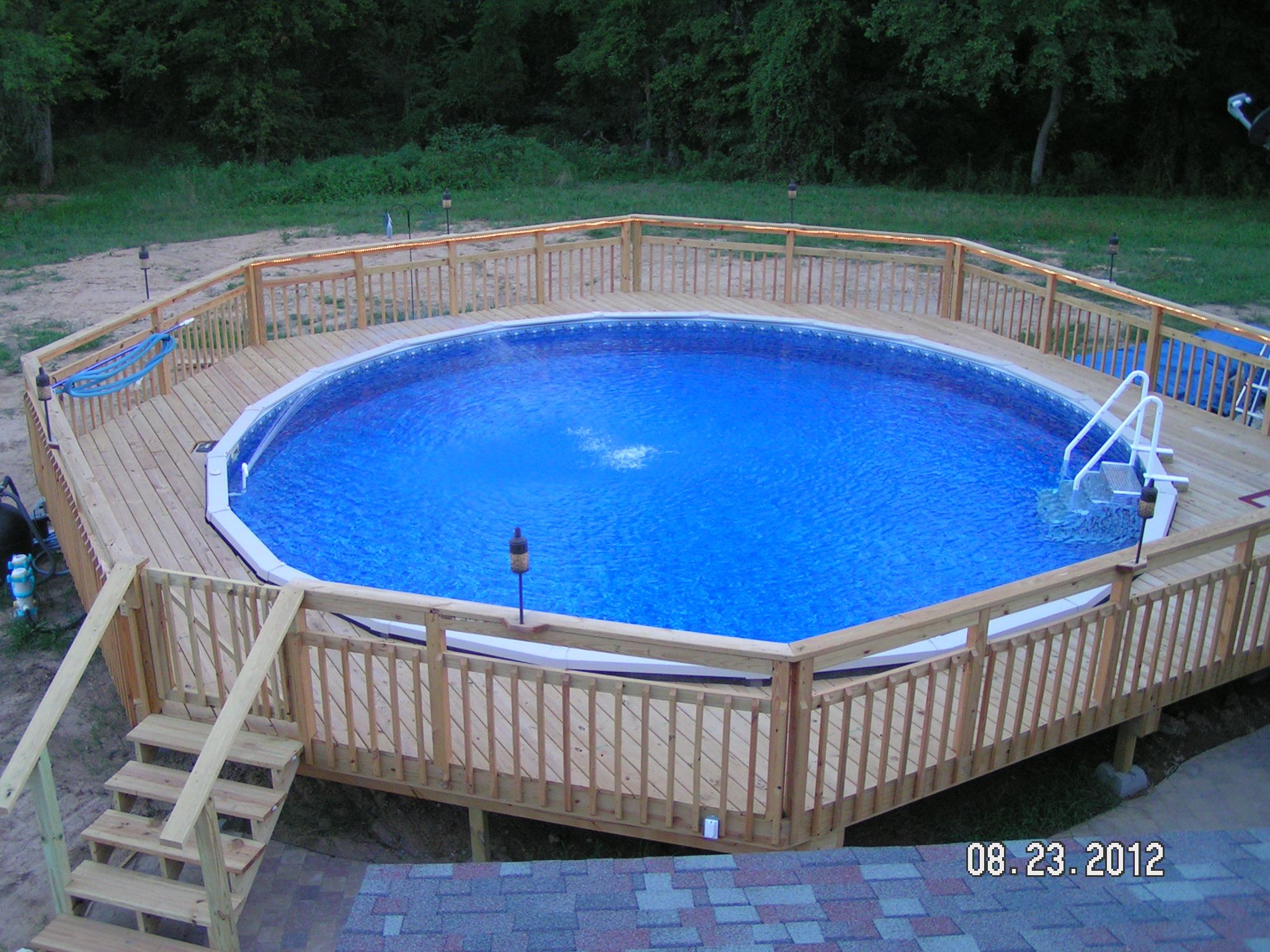 Doughboy pool with a walk around deck makes your summer amazing fun for the home for Doughboy above ground swimming pools