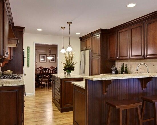 Rich Dark Cabinets W Blonde Hardwood Floors And Granite