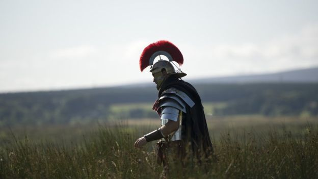 A man portraying a soldier from the Imperial Roman Army
