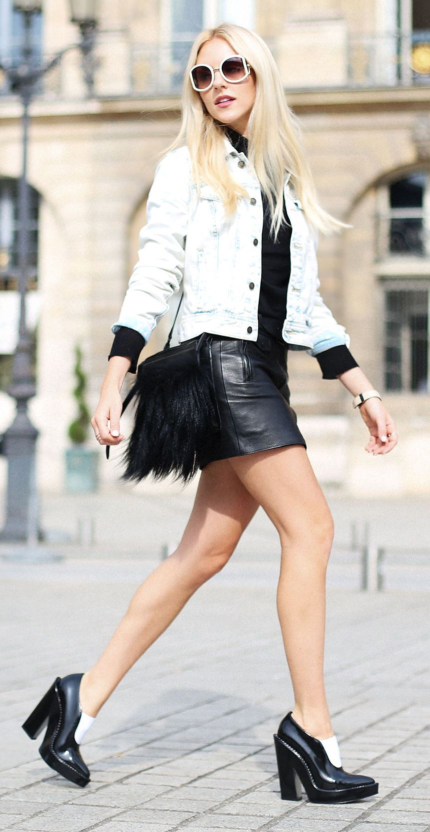 Shea Marie is wearing sunglasses from Ferragamo, mini leather skirt from A.L.C, shoes from Alexander Wang and a denim jacket from Free Peopl...