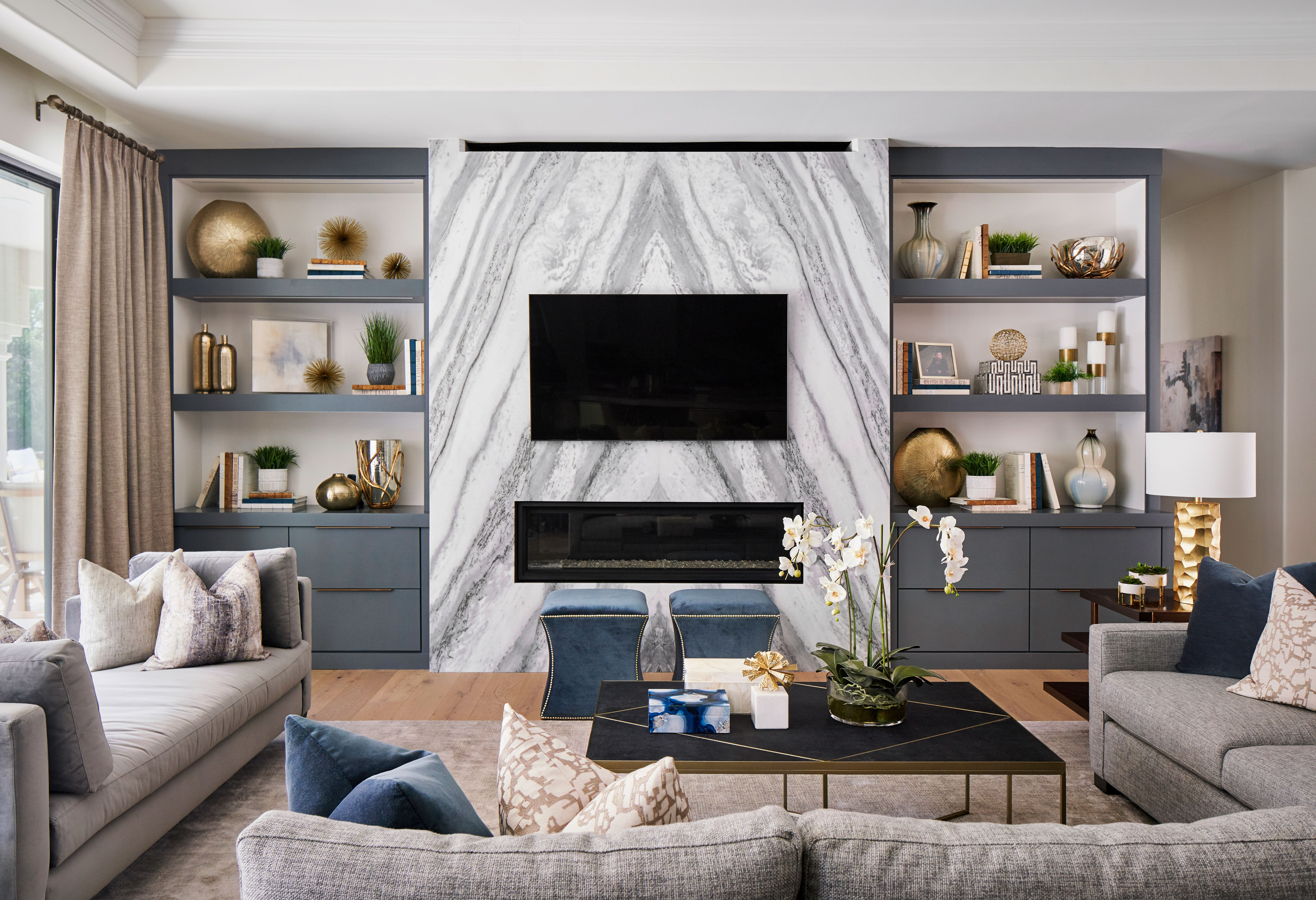Modern Bookmatched Marble Fireplace Wall With Bookcases