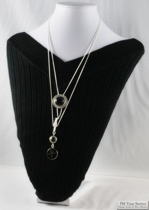 Silver plated ladies chain necklace, hanzi peace symbol pendant & slide with cabochon options.  $55, on Etsy.