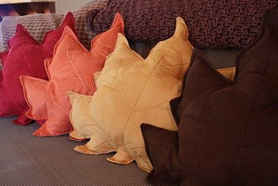 Fall pillows made from inexpensive placemats from Walmart.  Rip seam open a little, stuff them, and sew up edge.