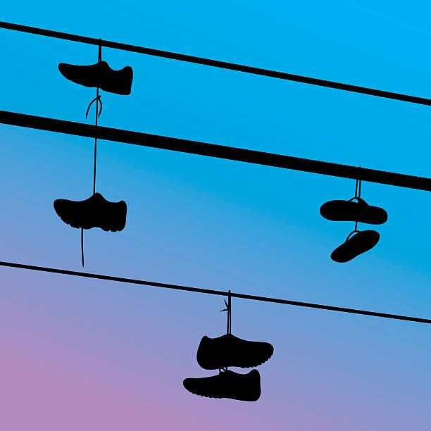 Shoes Hanging on Telephone Wire Silhouettes vector art illustration ...