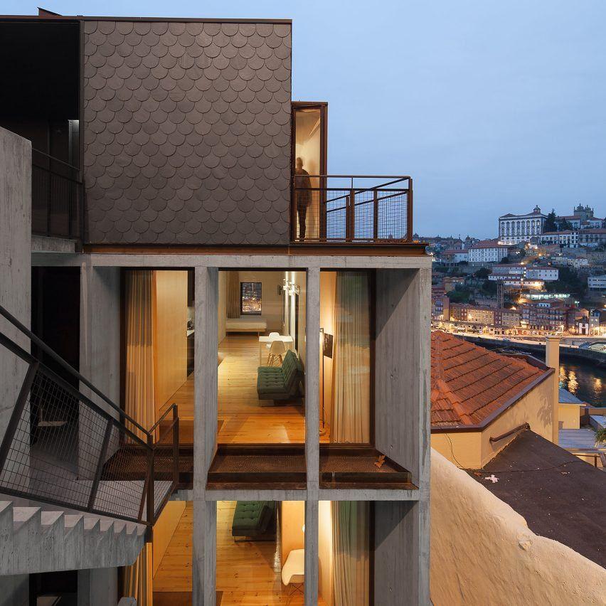 Concrete apartments slot into cliff overlooking Porto's Dom Luís I Bridge