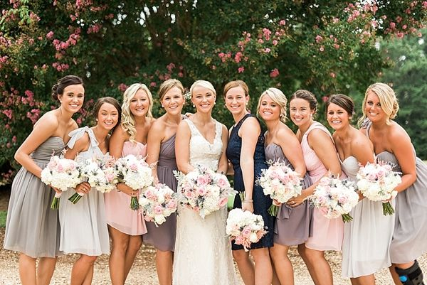 mismatched donna morgan bridesmaids dresses in shades of blush pink