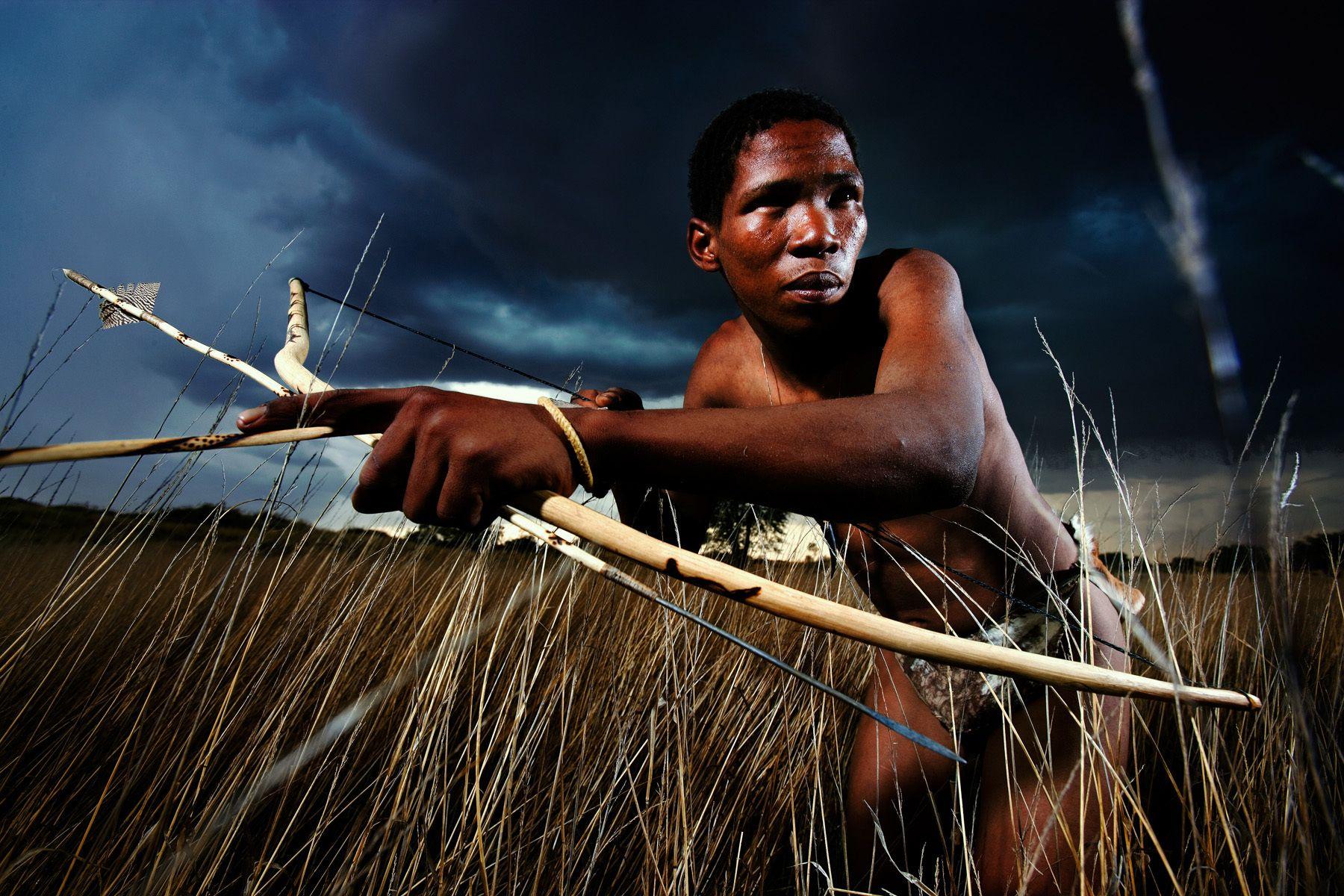 Kalahari San Bushmen hunting lions. Photo by Brent Stirton
