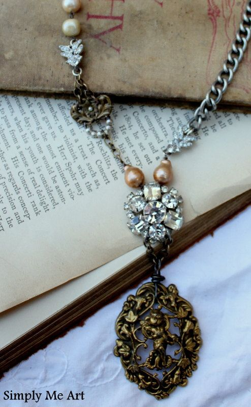 Items similar to ON SALE ...Vintage Rhinestone, Brass Finding, Pearl and Gemstone Assemblage Necklace...Cherub on Etsy