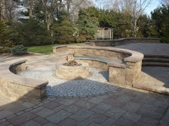 Outdoor Living For Patio Having Twin Curvy Stone Seating Areas And Stone  Fire Pit