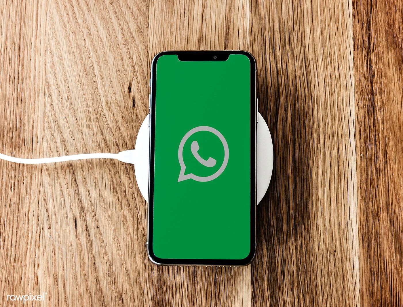 WhatsApp application showing on a phone free image by