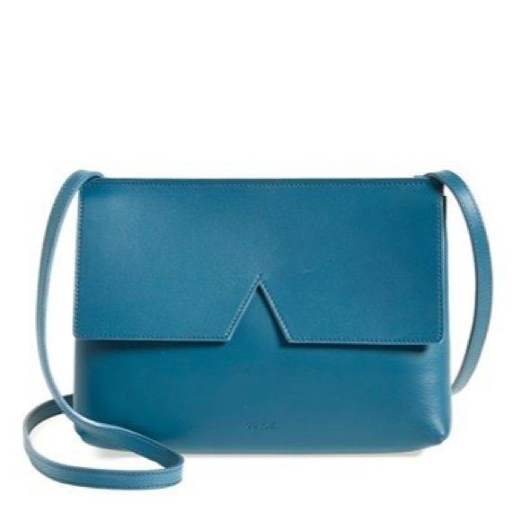 "NEW Vince signature collection crossbody Brand new with tags Vince crossbody bag in blue leather with silver metal. Perfectly compact/incredibly chic, this design can be worn three ways: with the strap on the shoulder or across the body, or without the strap as a small clutch. Its unique envelope construction and signature cut-out V detail is modern and streamlined in smooth Italian leather. 100% Italian leather; lined in cotton. 8 ¼"" x 6"" x 2"". Crossbody strap length: 22.5"". interior…"