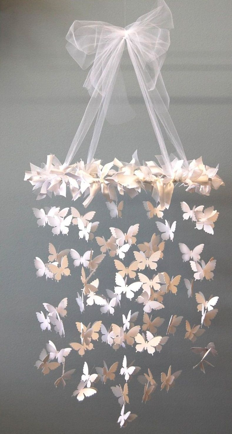 My daughter would love something like this in her room diy mobile i want my little girls room to be pink and grey with butterflies diy butterfly chandelier so pretty for a little girls room arubaitofo Image collections