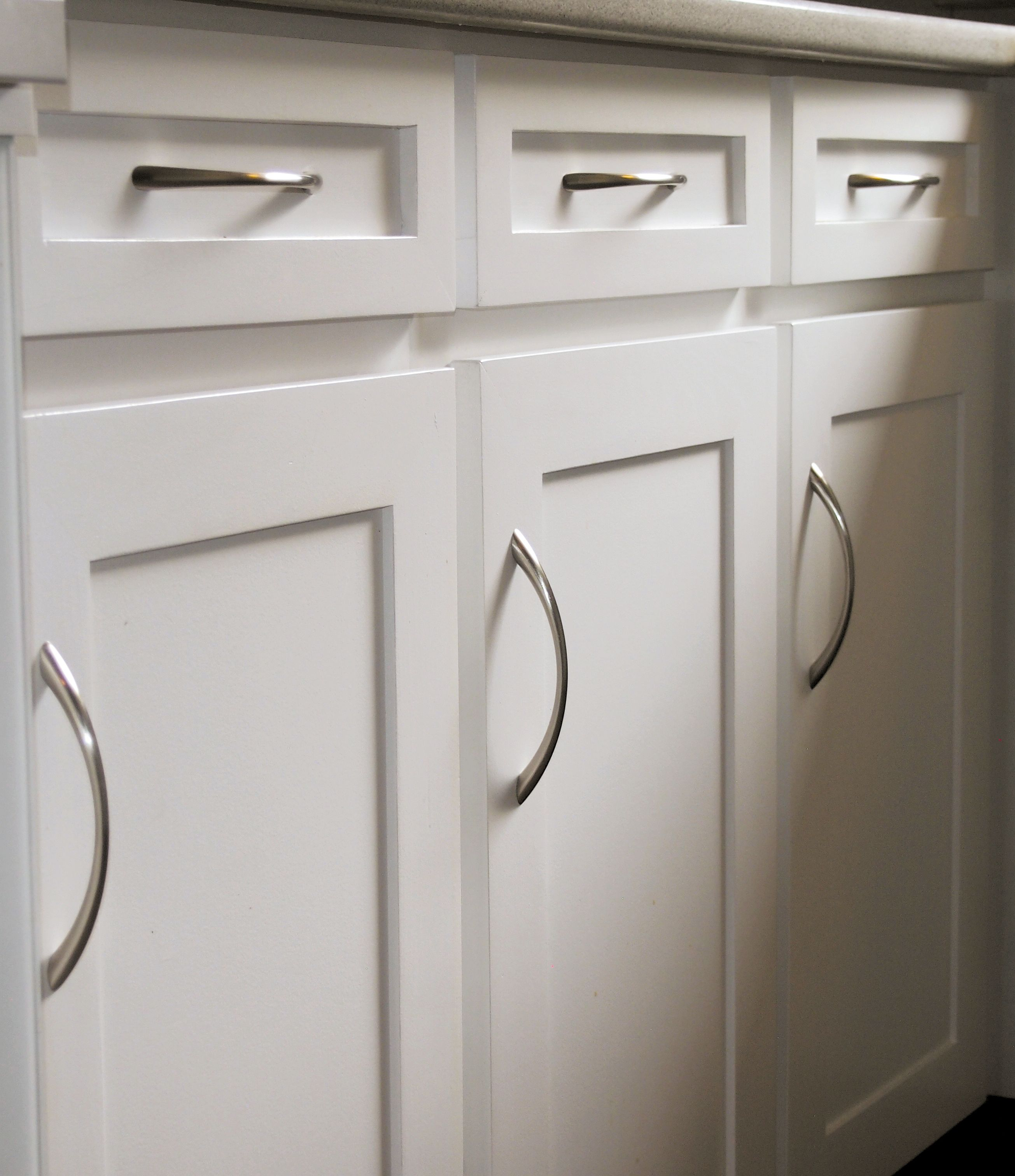 Clean Simple Kitchen Cabinet Doors And Drawer Fronts With Bow Pulls Finished White Water Based Melamine Paint