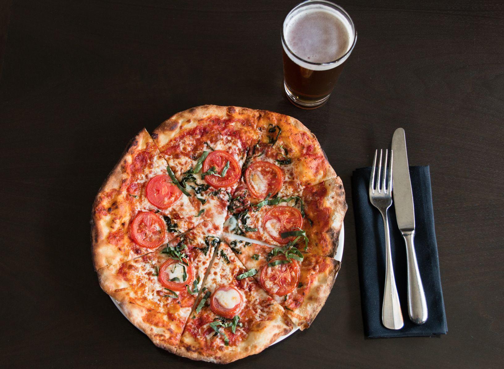 Margherita pizza:  sliced roma tomato, mozzarella di bufala, torn basil, olive oil