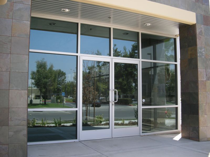 We repair and install store front glass doors for for Front door with window on top