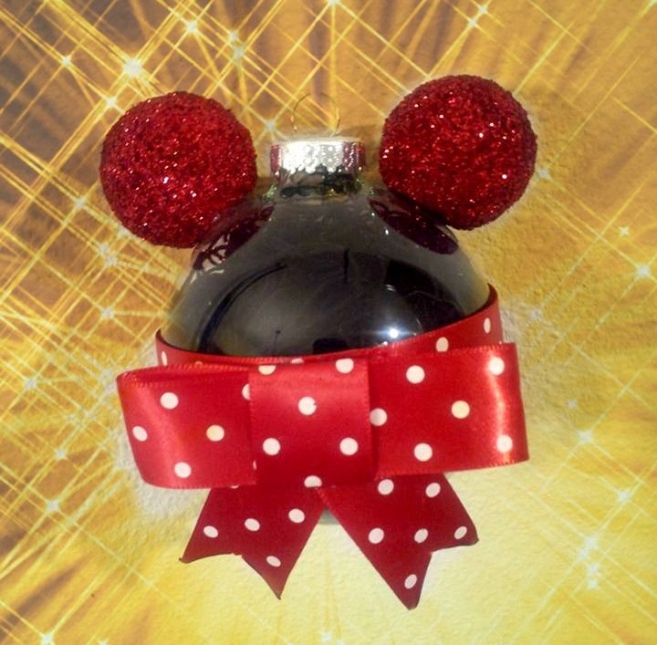 DIY Minnie Mouse Ornament Need: Black String, Red and White Polka-Dot Ribbon, Hot Glue(Gun), Styrofoam balls, Red Paint, Red Glitter Clear Ornament. What to do: Fill ornament with black string. Paint and sparkle ears. Make the bow. Hot glue ribbon bow and ears onto your new mickey ornament! Fun but the bow is difficult
