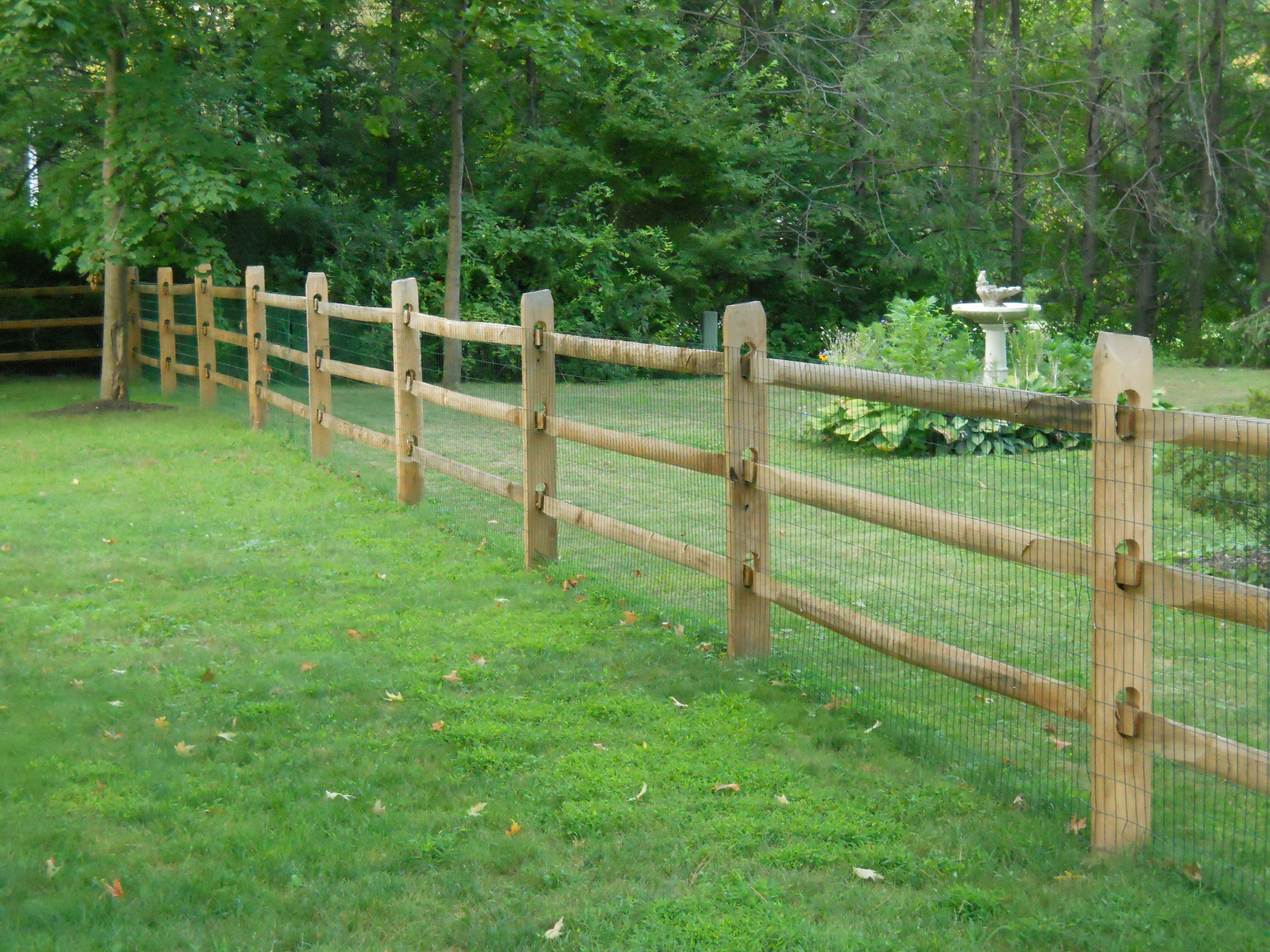 split rail fence with wire backing