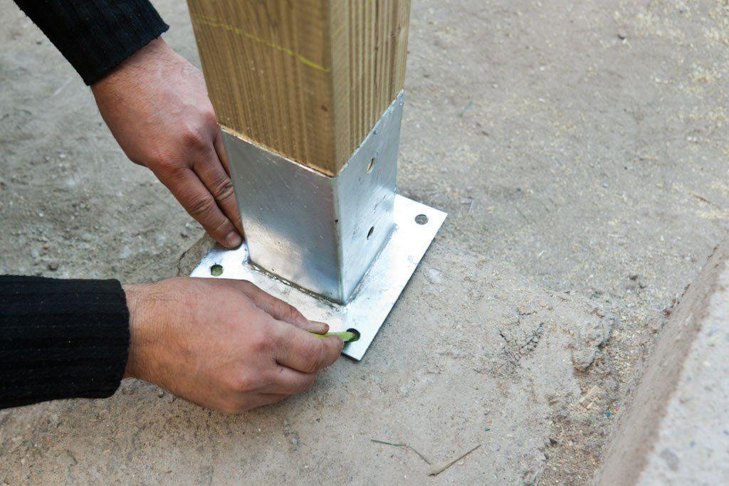 How To Anchor Post To Concrete Diy Deck Building A Deck Concrete Anchors