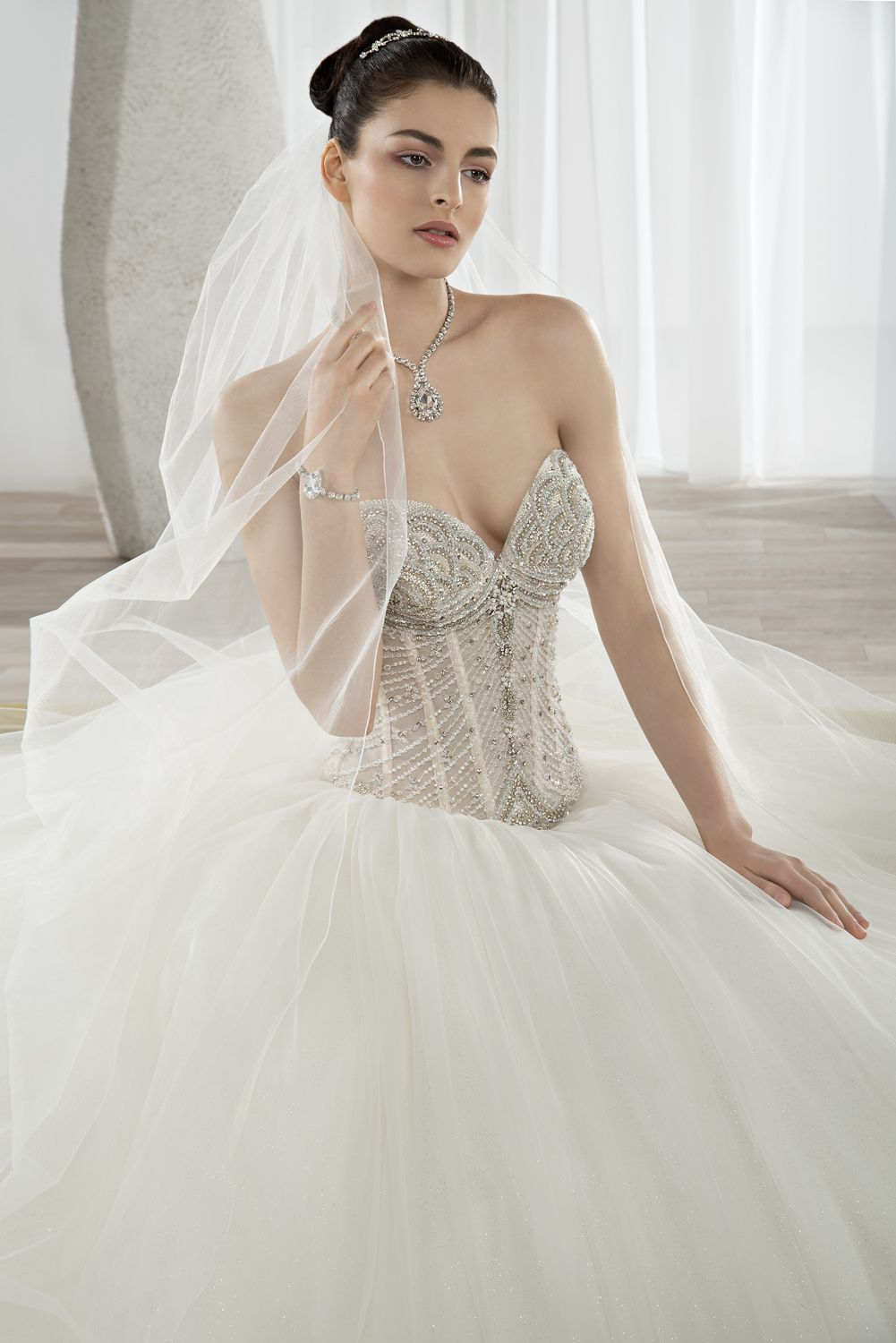 5f4004366ece4 ... Bridal Gown is Beaded Tulle. Shimmering sweetheart neckline bodice and  voluminous tulle skirt. #DemetriosBride Style 651.
