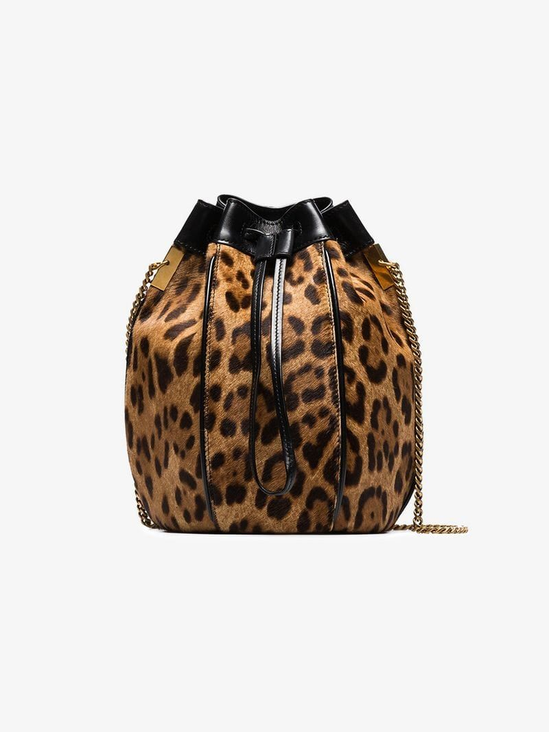 6b515a1e8c9b SAINT LAURENT | Talitha Bucket Bag | $2,915 | This brown and black Saint  Laurent Talitha leopard print bucket bag has been crafted by Italian  artisans with ...
