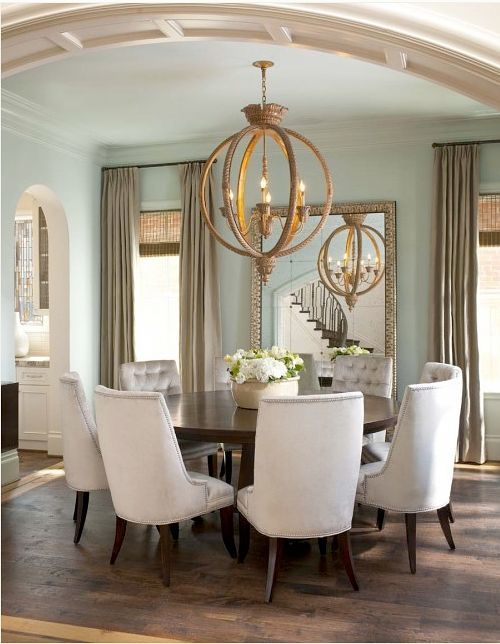 Neutral Light Dining Room Linen Chair Globe Iron Sphere Light Fixture Dining Room Renovation Dining Room Inspiration Dining Room Design