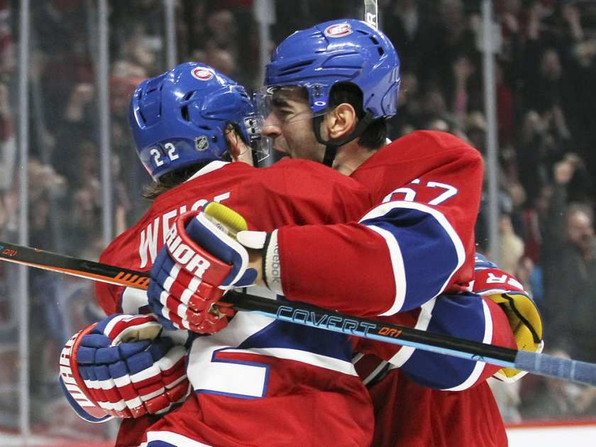 Montreal Canadiens Max Pacioretty celebrates his game-winning goal against the Columbus Blue Jackets with team-mate Dale Weise during third period of National Hockey League game in Montreal Tuesday December 1, 2015.